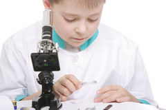 Boy working with magnifying glass Royalty Free Stock Images