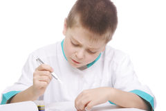 Boy working with tweezers Stock Photo
