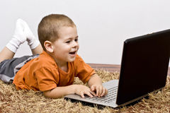 Boy working whit laptop Stock Image