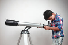 Boy works on a telescope Stock Photo