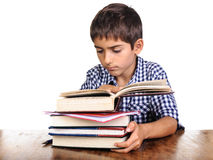 Boy worried expression looking in opened book Royalty Free Stock Photo