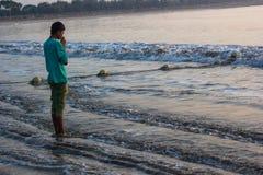 Boy worship ocean Stock Photos