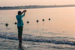 Boy worship ocean Royalty Free Stock Image