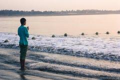 Boy worship ocean Royalty Free Stock Photo