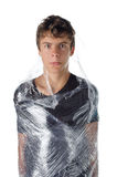 Boy wrapped in shrinkwrap cellophane Stock Photos