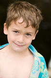 Boy wrapped in a towel. Child wrapped up in a towel after swimming Stock Image