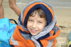 Boy wrapped in towel Stock Photos