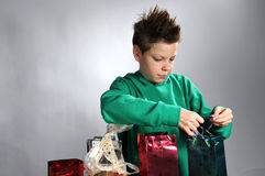 Boy wrapping gifts Royalty Free Stock Photography