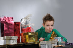 Boy wrapping gifts Royalty Free Stock Photos