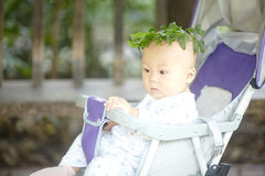 Boy in a wreath of leaves Royalty Free Stock Photography