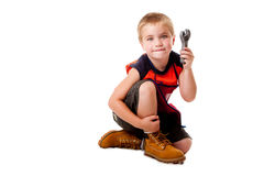 Boy with wrench Royalty Free Stock Photo