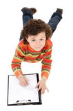 Boy write in clipboard Royalty Free Stock Photos
