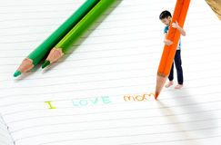 Boy write i love mom. Close up on macro size effect, Young Asian boy write on the note book by color pencil. I love mom. Mother day concept Stock Image