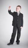 Boy writes Royalty Free Stock Photos