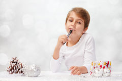 Boy writes a letter to Santa Claus. Royalty Free Stock Image