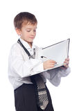 Boy writes in a notebook. Small boy writes in a notebook Royalty Free Stock Images