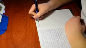 The boy writes in notebook homework on  Russian stock video footage