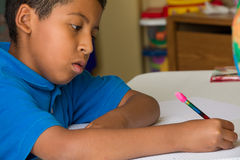 Boy Writing Stock Image