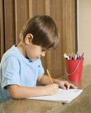 Boy writing. Stock Photography
