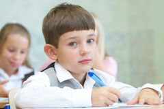 The boy writing. Children writing in a class stock images