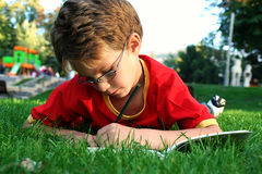 Boy writing Royalty Free Stock Images