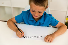 Boy writing the ABC alphabet Royalty Free Stock Images