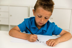 Boy writing the ABC alphabet Royalty Free Stock Photo