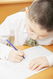 Boy writing above view Royalty Free Stock Photos
