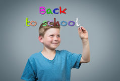 Boy writing back to school Stock Photo
