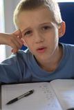 Boy writing homework Royalty Free Stock Photo