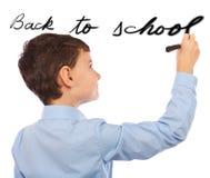 Boy writing on imaginary board Stock Photos