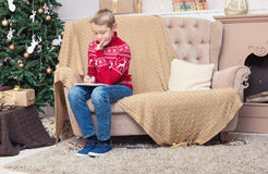 A boy writing a letter to Santa Claus Stock Images