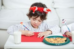 Boy Writing Letter To Santa Claus Royalty Free Stock Images