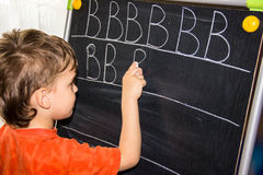 Boy writing letters learning process Stock Photos