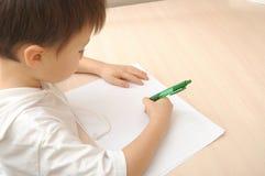 Boy writing Royalty Free Stock Photography