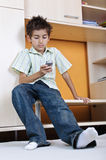 Boy writing message at mobile phone Royalty Free Stock Images