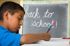 Boy Writing Ready for Back to School Royalty Free Stock Photos