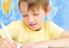 Boy writing Royalty Free Stock Photo