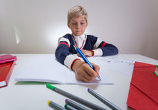 Boy writing something in notebook Royalty Free Stock Images