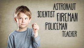 Boy writing, thinking, career aspiration Royalty Free Stock Image