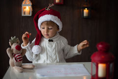 Boy, writing to Santa Stock Photography