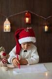 Boy, writing to Santa Stock Photo
