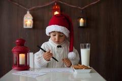 Boy, writing to Santa Stock Photos