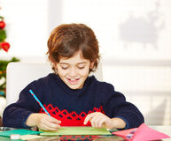 Boy writing wishlist for christmas Royalty Free Stock Photos