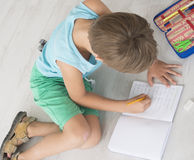 Boy writting Royalty Free Stock Images
