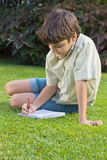 boy  writting in note book Royalty Free Stock Photo