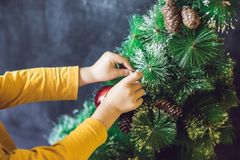 The boy wrote an inscription Merry Cristmas. Christmas tree. Xma. S child and New Year holiday Merry Cristmas your family Stock Photography