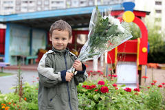 Boy 3-4 years old with flowers Stock Photography