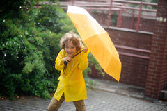 Boy of 8-9 years in the rain. Stock Photography
