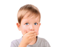 Boy 5 years shut by the hand mouth. Horizontal Image isolated on white background Royalty Free Stock Photo